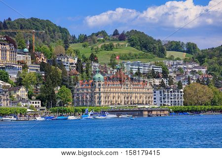 Lucerne, Switzerland - 8 May, 2016: view on Lake Lucerne from the Bahnhofquai quay - people in boats, Hotel Palace building in the background. Lake Lucerne is a lake in central Switzerland, the fourth largest in the country.