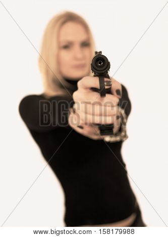 Female secret service agent in sunglasses with gun. Toned Image