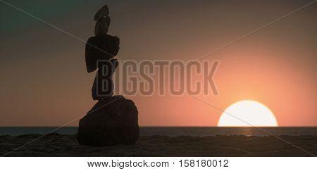 Stone piramide. Sea sunset. Toned Image