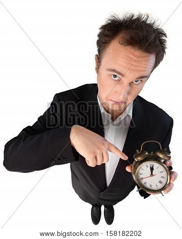 Young Man In Suit Presenting Alarm Clock Top-down View - Isolated