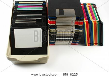 Floppy discs in stacks and in a box, isolated on white