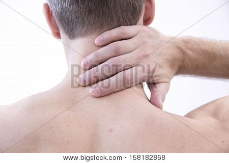 Pain in the neck. Man with backache. Muscular male body. Isolated on white background with red dot. healthcare and problem concept - unhappy man suffering from neck or shoulder pain at home