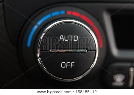 Closeup of Air Conditioning Knob in a Car
