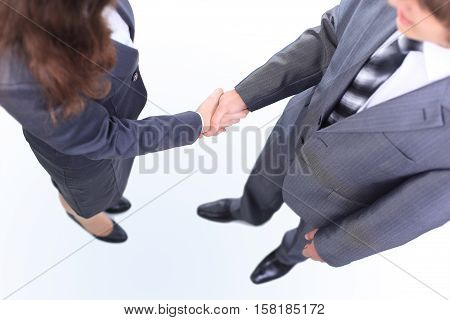 Handshake of the two businessmen agreed in the contract. Isolated on a white background.