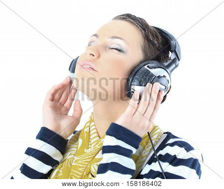 Beautiful girl with headphones. Isolated on a white background