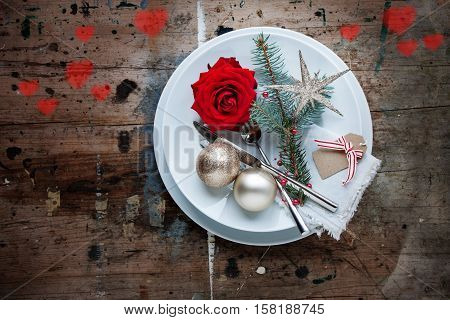 Table decoration for a Christmas dinner in shabby chic style mit loving Heart