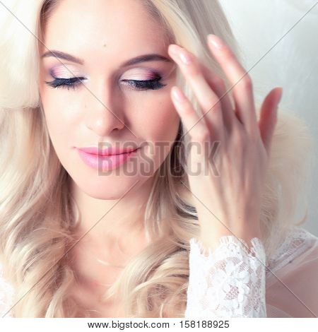Portrait of a beautiful blonde women with bridal makeup and curls. Tenderness