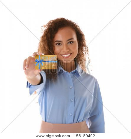 Young woman with gift card on white background. Holiday celebration concept.