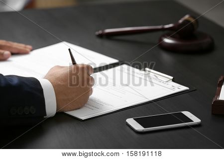 Man signing power of attorney, closeup