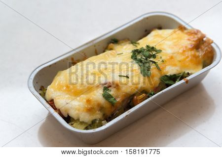 Trout baked with vegetables and cheese in a batch trays