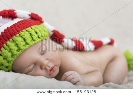 Sleeping Newborn Baby In A Wrap