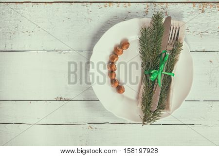Christmas Decoration Cutlery On Old Wooden Background
