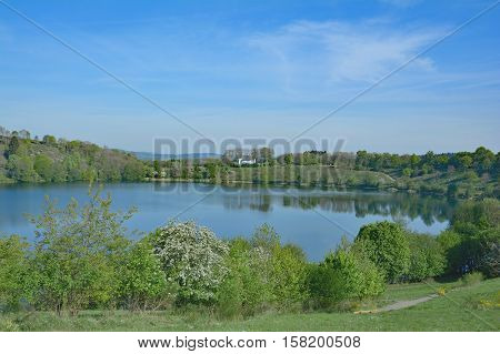volcano Lake called Weinfelder Maar in Eifel volcan region near Daun,Rhineland-Palatinate,Germany