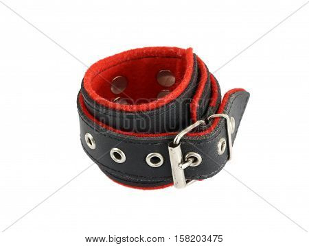 Leather cuffs for hands and legs for erotic games on white background