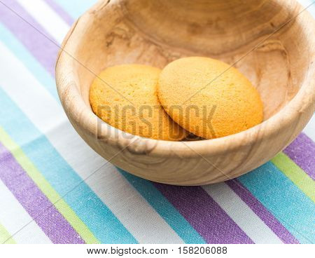 Biscuits Cakes In Wooden Bowl On Table