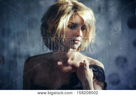 Pensive Woman Calmly Sitting Near Window Shades.
