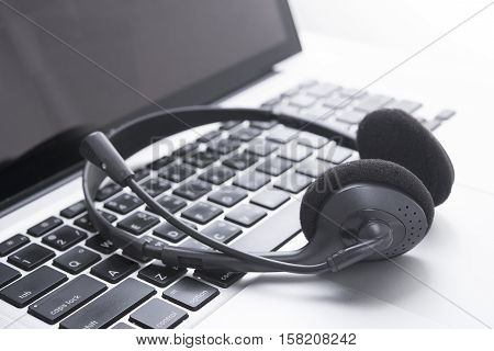 headset and computer laptop call center support and customer service help concept for communication