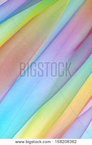 closeup of organza fabric in rainbow color