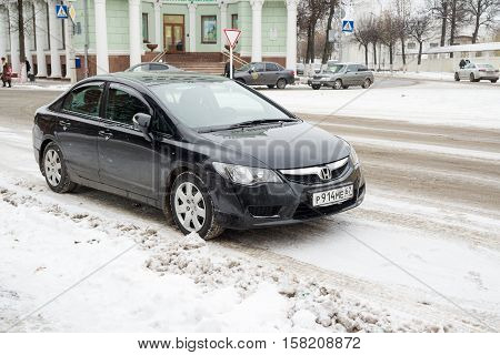 Smolensk, Russia - November 12, 2016: Honda Civic Hybrid parked in winter street. A variation of the Honda Civic with a hybrid electric powertrain.