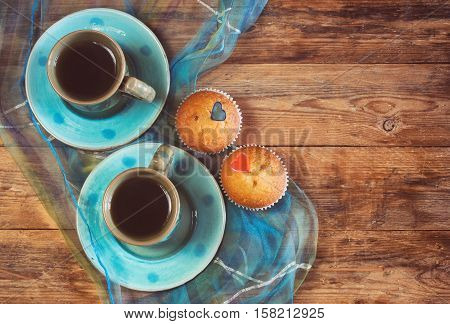 valentine's day couple cups of coffee two sweet cake hearts silk cloth on wooden table