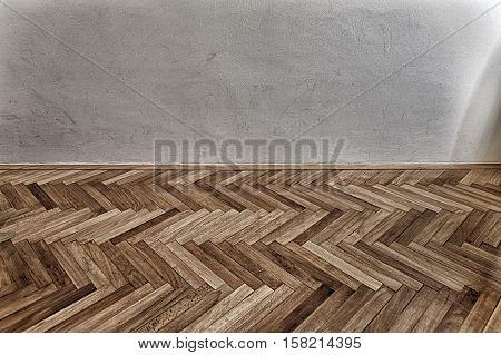 hardwood parquet floor and grunge grey wall