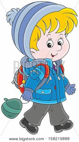 Little schoolkid in a winter jacket and a warm hat and mittens going with a schoolbag