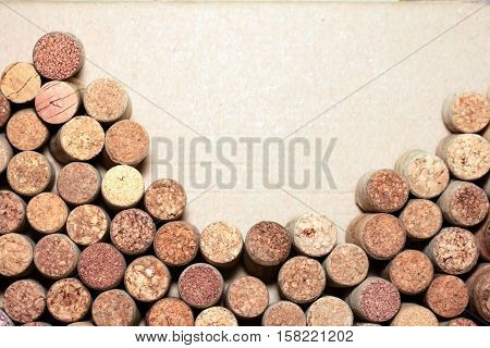 Wine corks on paper background for your text.