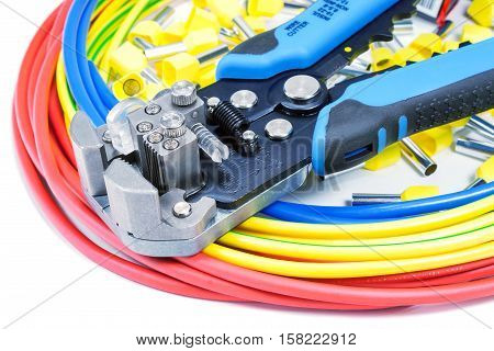 Power wires with cable stripper and cord end terminals on a white background