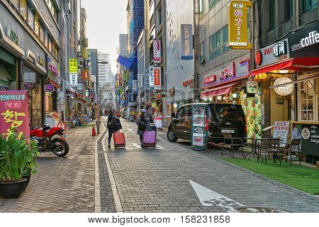 Asian Travelers In The Center Of Seoul