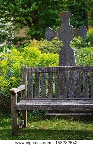 Bench And Cross At Churchyard Cemetery At Bristol Cathedral Uk