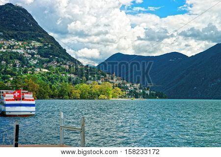 Boat With Flag At Promenade Lugano In Ticino Switzerland