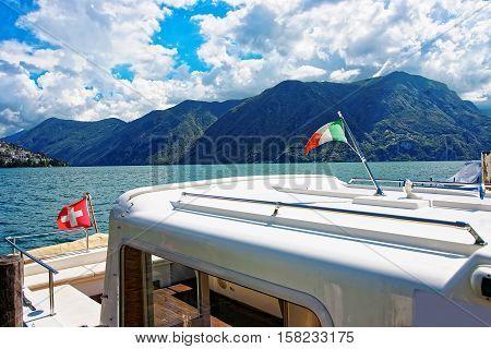 Boat With Flag At Promenade In Lugano In Ticino Switzerland
