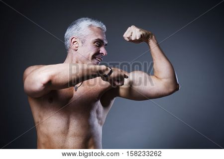 Strong Athletic Man Fitness Model Torso showing flexing bicep muscle (Healthy lifestyle sports fitness strength beauty)