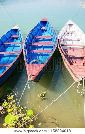 Boats on Phewa Lake in Pokhara in Nepal