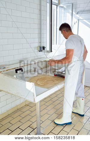 Cheesemaker Weighs Gruyere De Comte Cheese At The Dairy