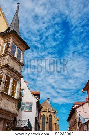 Rue de Eglise Street and fragment of St Martin Church in Colmar Haut Rhin at Alsace of France.