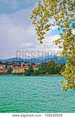Houses At Lake Lugano And Mountains In Ticino Switzerland