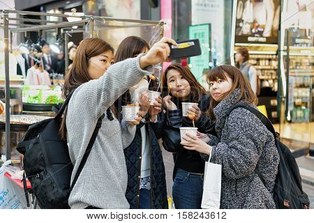 Korean Girls Tasting Street Food In Myeongdong Market Seoul