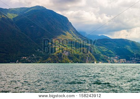 Lake Lugano And Alps Mountains In Ticino Of Switzerland