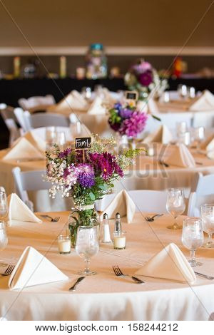 A table for family members is waiting for wedding guests to arrive