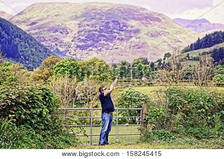 Man enjoying the chain of mountains in Snowdonia National Park in North Wales of the United Kingdom. Snowdonia is a mountain range and a region in North of Wales.