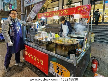 Man Selling Food At Myeongdong Open Street Market In Seoul
