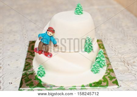 Mastic cake in mountain form with skier, closeup