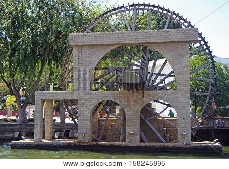 People Are Walking Nearly The Ancient Wooden Water Wheel