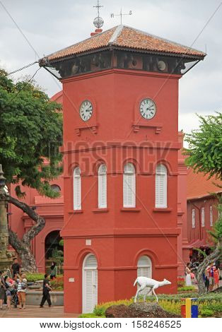 People Are Walking Nearly The Clock Tower In Malacca