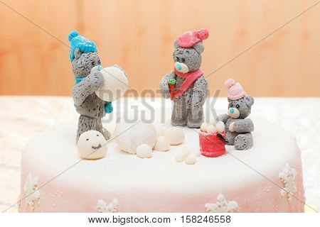 Mastic cake decorated with winter teddy bears, closeup