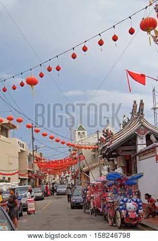 Malacca Malaysia - April 10 2015: people are walking by the old town in Malacca Malaysia