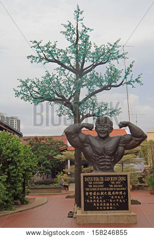Malacca Malaysia - April 10 2015: Statue of Datuk Wira Dr. Gan Boon Leong the father of bodybuilding in Malaysia and a former Mr. Universe in the Chinatown neighborhood of Malacca