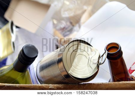 Wine bottle beer bottle and can in a box of domestic packaging waste ready for recycling. Recycling domestic waste is essential for an environmentally friendly lifestyle