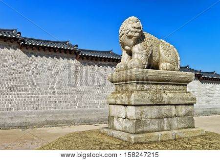 Mythological lion Haechi statue at the entrance gate to Gyeongbokgung Palace in Seoul South Korea poster